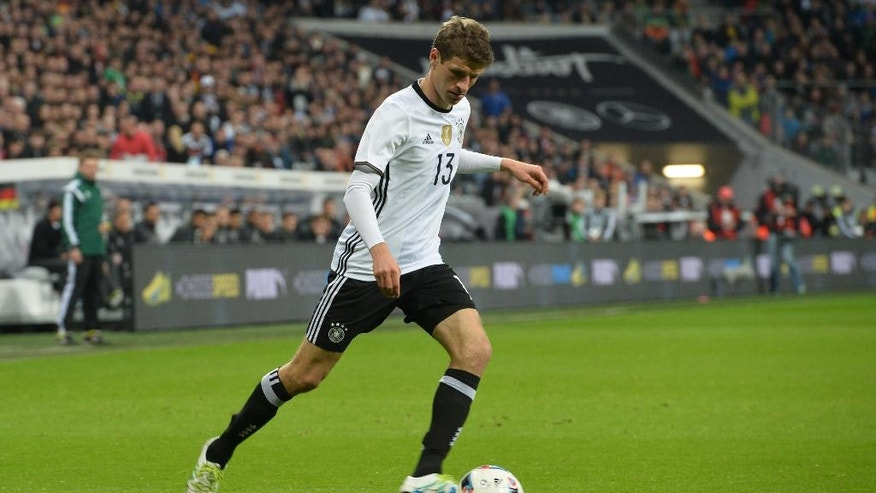 In this photo taken on Tuesday, March 29, 2016, Germany's Thomas Mueller kicks the ball during a friendly soccer match between Germany and Italy at the Allianz Arena in Munich, southern Germany. (AP Photo/Kerstin Joensson)