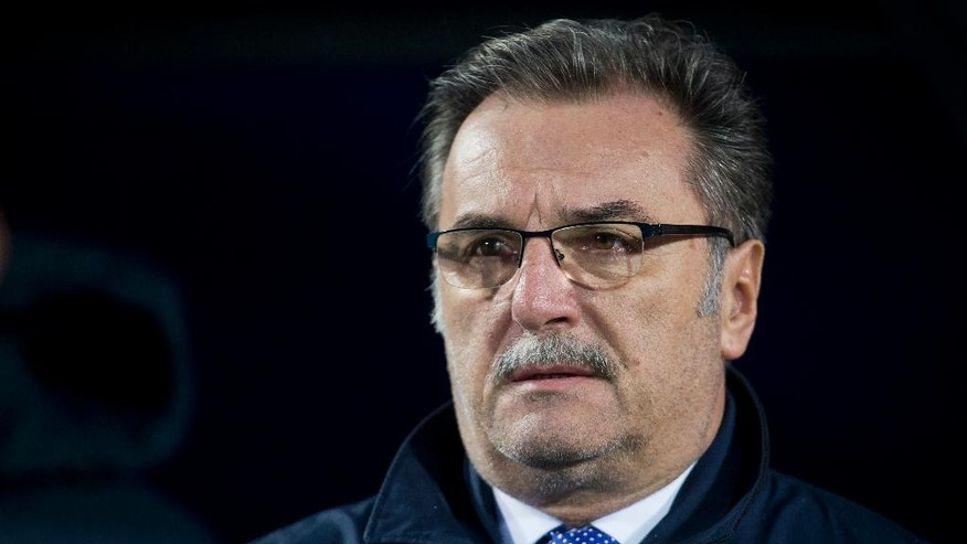 FILE - In this Wednesday, March 23, 2016 file photo, Croatia's head coach Ante Cacic listens to the national anthems ahead of the international friendly soccer match between Croatia and Israel in Osijek, Croatia. (AP Photo/Darko Bandic, File)
