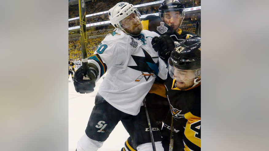 San Jose Sharks' Chris Tierney, left, collides with Pittsburgh Penguins' Sidney Crosby, rear, and Conor Sheary, right, during the third period in Game 2 of the NHL hockey Stanley Cup Finals on Wednesday, June 1, 2016, in Pittsburgh. (AP Photo/Keith Srakocic)