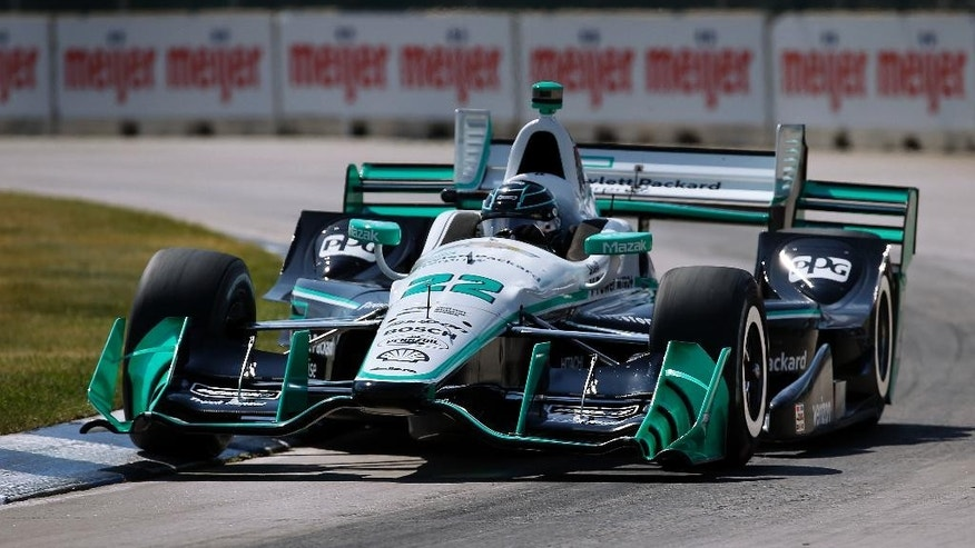 Simon Pagenaud, of France, exits a turn during qualifications for race one of the IndyCar Detroit Grand Prix auto racing double header on Belle Isle in Detroit, Friday, June 3, 2016. Pagenaud won the pole position. (AP Photo/Paul Sancya)