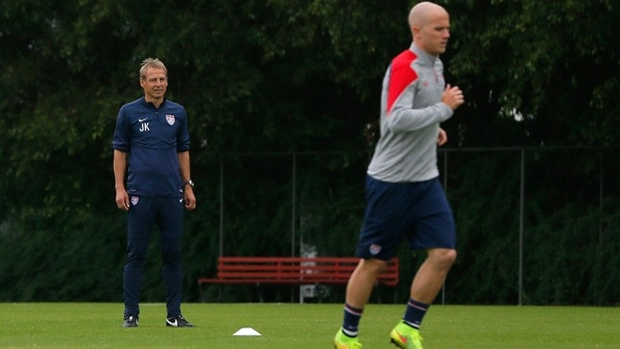 Head coach Jurgen Klinsmann of the United States looks on as Michael Bradley works out during a training session. (Photo by Kevin C. Cox/Getty Images)