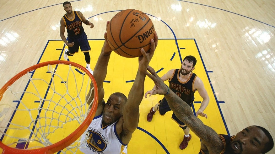 June 2, 2016: Golden State Warriors forward Andre Iguodala (9) dunks against the Cleveland Cavaliers during the first half of Game 1 of basketball's NBA Finals in Oakland, Calif.