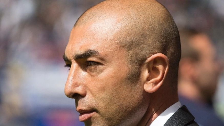 FILE - A Saturday, May 23, 2015 photo from files showing the then Schalke coach Roberto Di Matteo prior to the German first division Bundesliga soccer match between Hamburger SV and Schalke 04 in Hamburg, Germany. Roberto Di Matteo has been hired by Aston Villa, it was announced Friday, June 3, 2016, ensuring there will be two Champions League-winning managers in English soccer's second tier next season after Rafa Benitez opted to stay at Newcastle. (AP Photo/Joerg Sarbach, File)