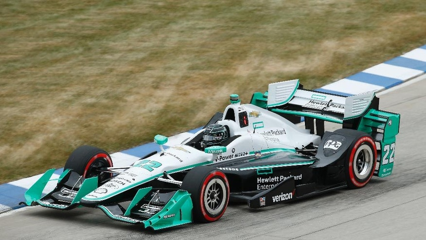 Pole sitter Simon Pagenaud races during race one of the IndyCar Detroit Grand Prix auto racing doubleheader on Belle Isle in Detroit, Saturday, June 4, 2016. (AP Photo/Paul Sancya)