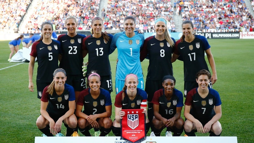 In this photo taken Thursday, June 2, 2016, the United States team poses for a team photo before their international friendly soccer match against the Japan in Commerce City, Colo.