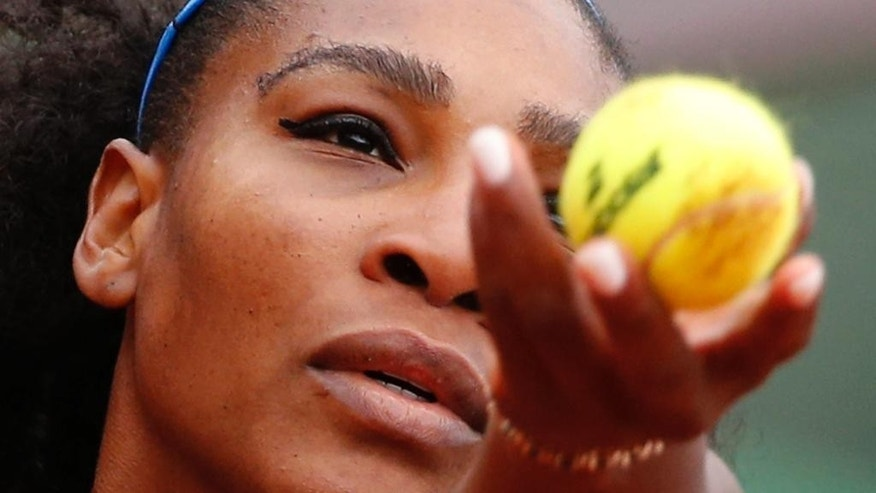 Serena Williams of the U.S. serves the ball in the semifinal match of the French Open tennis tournament against Netherlands' Kiki Bertens at the Roland Garros stadium in Paris, France, Friday, June 3, 2016. (AP Photo/Alastair Grant)