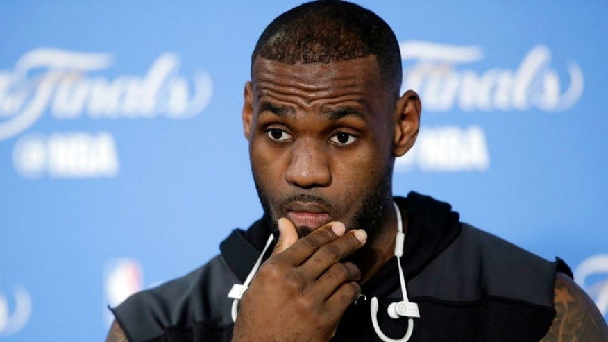Cleveland Cavaliers' LeBron James answers questions before an NBA basketball practice Wednesday, June 1, 2016, in Oakland, Calif. The Golden State Warriors host the Cleveland Cavaliers in Game 1 of the NBA finals on Thursday. (AP Photo/Marcio Jose Sanchez)