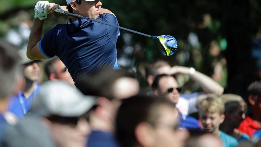 Rory McIlroy, of Northern Ireland, watches his tee shot on the 15th hole during the second round of the Memorial golf tournament, Friday, June 3, 2016, in Dublin, Ohio. (AP Photo/Darron Cummings)