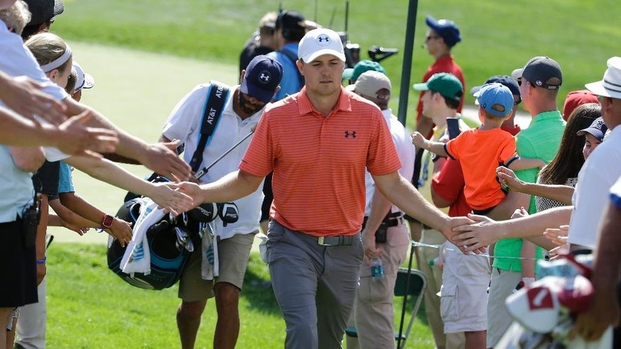 Jordan Spieth walks to the 14th tee during the second round of the Memorial golf tournament, Friday, June 3, 2016, in Dublin, Ohio. (AP Photo/Darron Cummings)