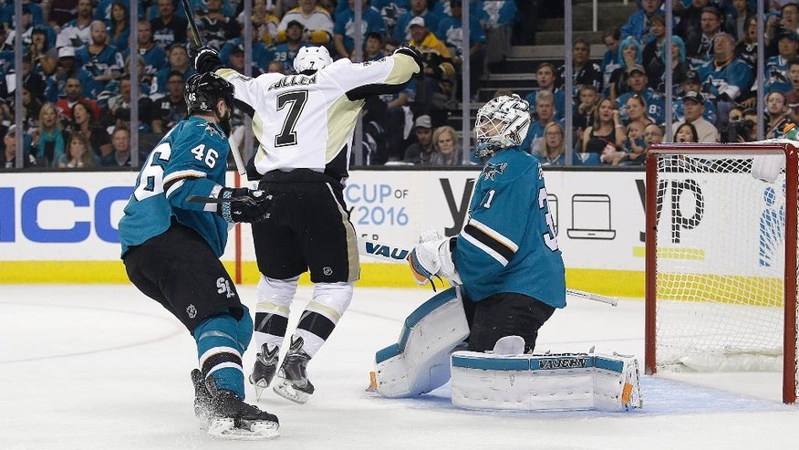 Pittsburgh Penguins center Matt Cullen (7) celebrates after teammate Ben Lovejoy scored a goal as San Jose Sharks defenseman Roman Polak (46), from the Czech Republic, and goalie Martin Jones react during the first period of Game 3 of the NHL hockey Stanley Cup Finals in San Jose, Calif., Saturday, June 4, 2016. (AP Photo/Marcio Jose Sanchez)