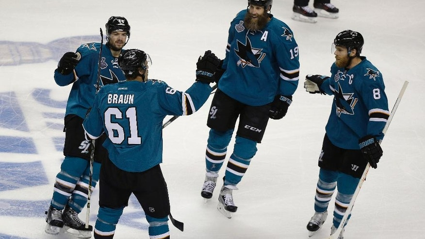 San Jose Sharks defenseman Justin Braun (61) celebrates with teammates after scoring a goal against the Pittsburgh Penguins during the first period of Game 3 of the NHL hockey Stanley Cup Finals in San Jose, Calif., Saturday, June 4, 2016. (AP Photo/Eric Risberg)