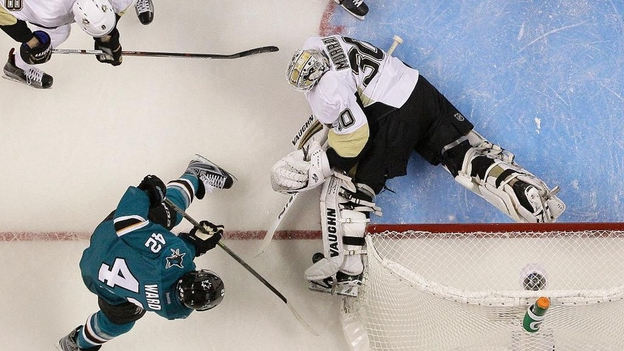 Pittsburgh Penguins goalie Matt Murray (30) defends a shot by San Jose Sharks right wing Joel Ward (42) during the second period of Game 3 of the NHL hockey Stanley Cup Finals in San Jose, Calif., Saturday, June 4, 2016. (AP Photo/Marcio Jose Sanchez)