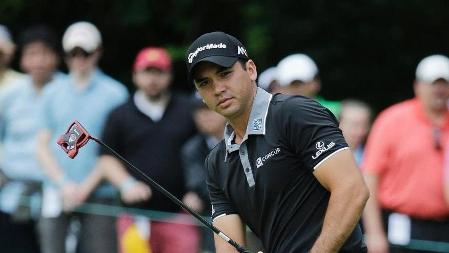 Jason Day, of Australia, watches his putt on the second hole during the final round of the Memorial golf tournament, Sunday, June 5, 2016, in Dublin, Ohio. (AP Photo/Darron Cummings)