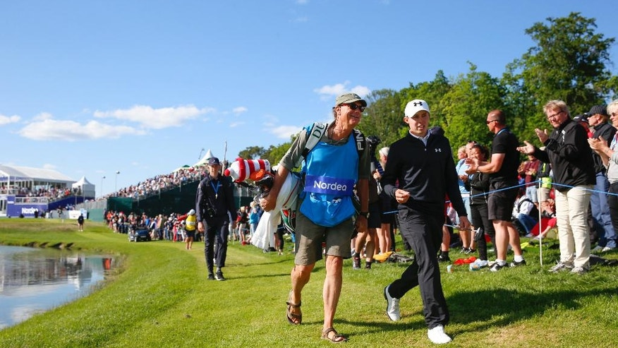 England's Matthew Fitzpatrick leaves the 17th tee with his caddie during the last round of the Nordea Masters golf tournament at the Bro Hof golf club, Stockholm,  Sunday June 5, 2016. (Fredrik Persson/TT via AP)  SWEDEN OUT