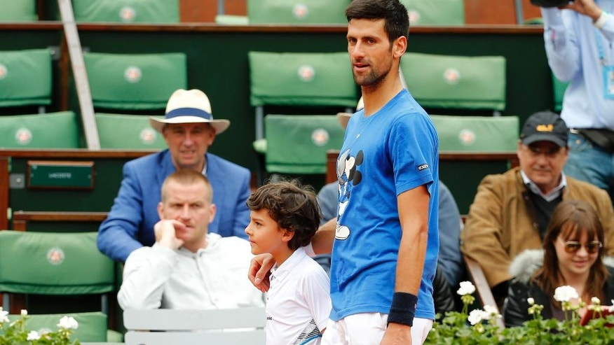 Serbia's Novak Djokovic leaves the court after a training session for the French Open tennis tournament at the Roland Garros stadium, Saturday, June 4, 2016 in Paris.  (AP Photo/Alastair Grant)
