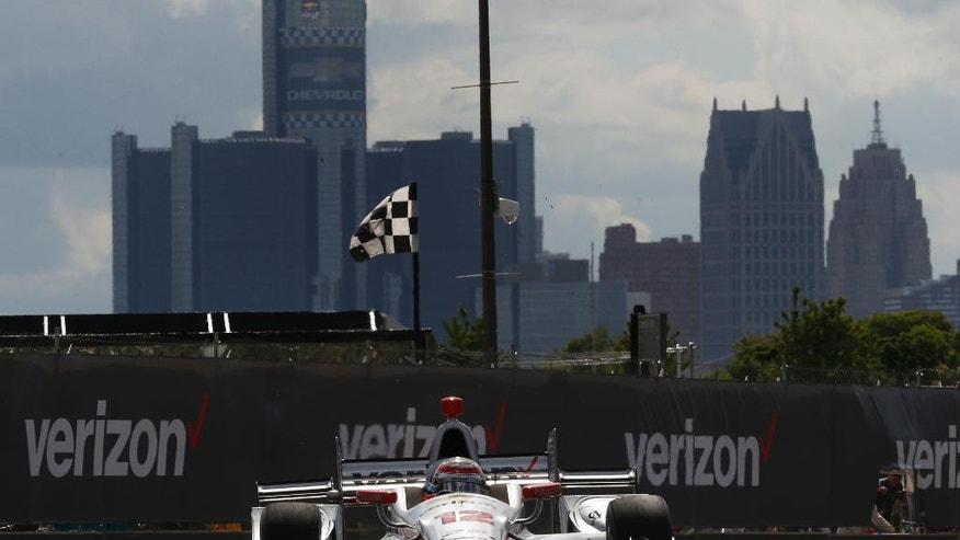 Will Power exits a turn during race two of the IndyCar Detroit Grand Prix auto racing doubleheader on Belle Isle in Detroit, Sunday, June 5, 2016. (AP Photo/Paul Sancya)