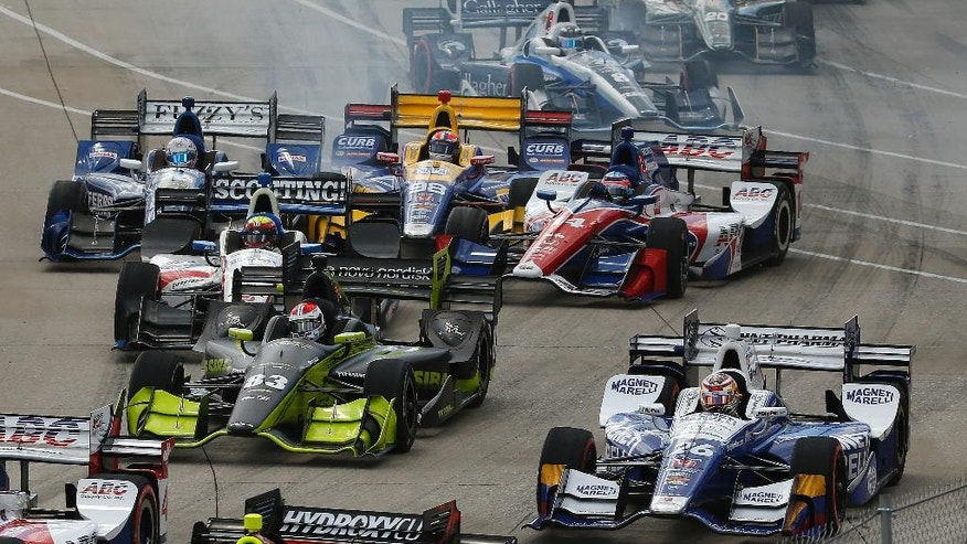 Takuma Sato (14) and Max Chilton (8) get sideways in turn one on the opening lap during race two of the IndyCar Detroit Grand Prix auto racing double header on Belle Isle in Detroit, Sunday, June 5, 2016. (AP Photo/Paul Sancya)