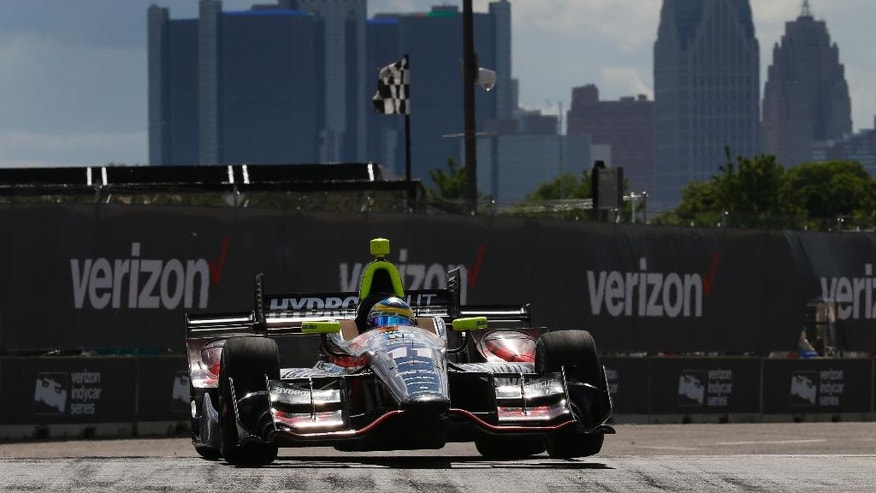 Sebastien Bourdais exits a turn during race two of the IndyCar Detroit Grand Prix auto racing doubleheader on Belle Isle in Detroit, Sunday, June 5, 2016. (AP Photo/Paul Sancya)