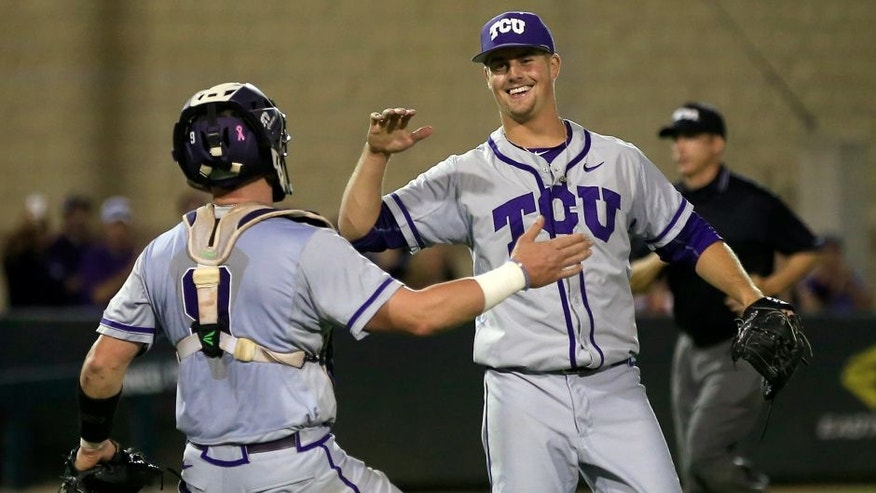 TCU catcher Evan Skoug, left, and pitcher Brian Trieglaff, right, celebrate following the ninth inning against Arizona State in an NCAA college baseball regional tournament game in Fort Worth, Texas, Sunday, June 5, 2016. TCU won 8-1. (AP Photo/Ron Jenkins)