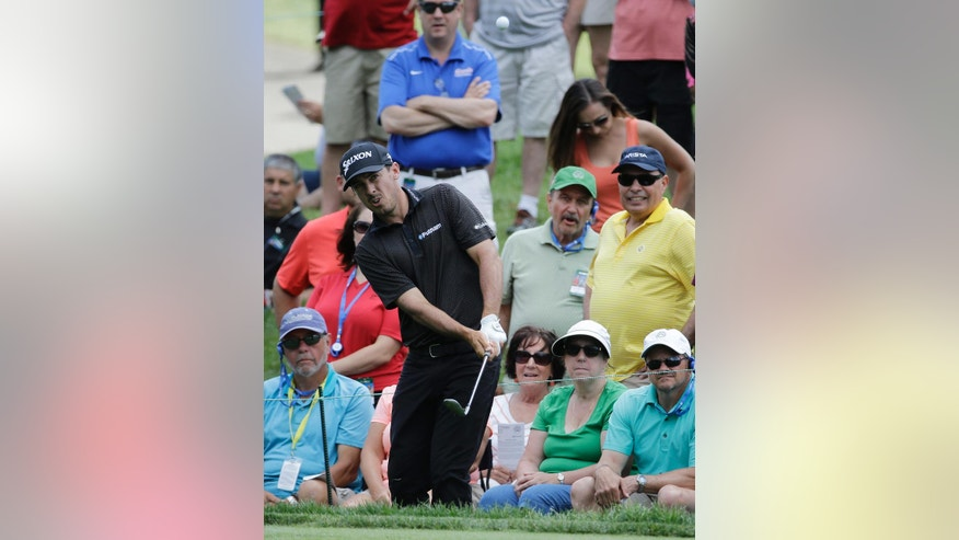 Jon Curran hits to the ninth green during the final round of the Memorial golf tournament, Sunday, June 5, 2016, in Dublin, Ohio. (AP Photo/Darron Cummings)