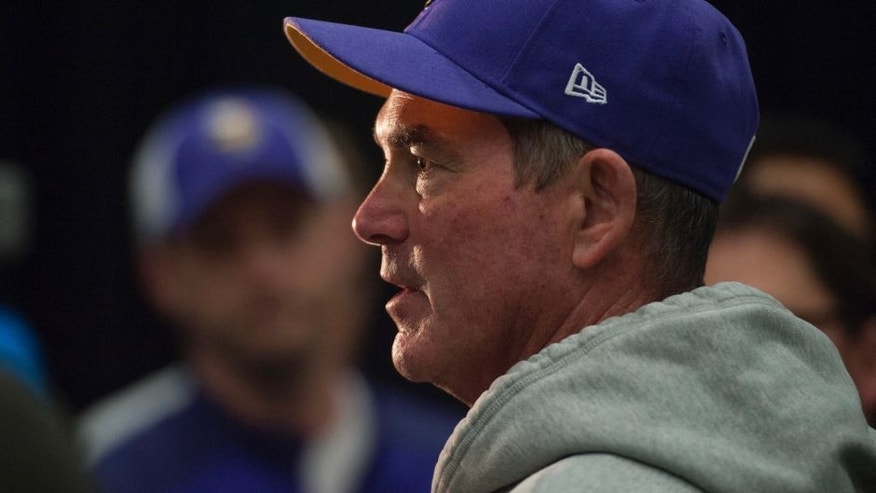 <p>Minnesota Vikings head coach Mike Zimmer talks with reporters after NFL football practice in Eden Prairie, Minn., Wednesday, May 25.</p>