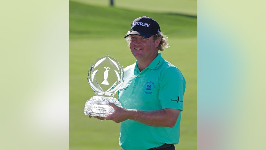 William McGirt holds the trophy after winning the Memorial golf tournament in a playoff, Sunday, June 5, 2016, in Dublin, Ohio. (AP Photo/Darron Cummings)