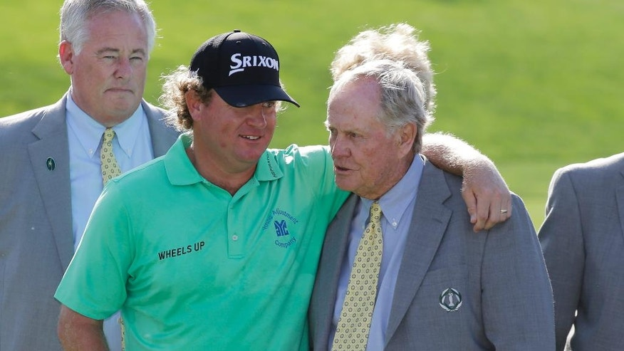Jack Nicklaus talks with William McGirt after McGirt won the Memorial golf tournament in a playoff, Sunday, June 5, 2016, in Dublin, Ohio. (AP Photo/Darron Cummings)