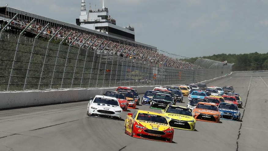 Joey Logano leads the field into Turn 1 during the NASCAR Sprint Cup series auto race at Pocono Raceway, Monday, June 6, 2016, in Long Pond, Pa. (AP Photo/Matt Slocum)