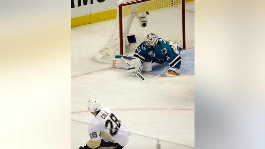 Pittsburgh Penguins' Ian Cole (28) scores a goal against San Jose Sharks' Martin Jones during the first period of Game 4 of the NHL hockey Stanley Cup Finals on Monday, June 6, 2016, in San Jose, Calif. (AP Photo/Eric Risberg)