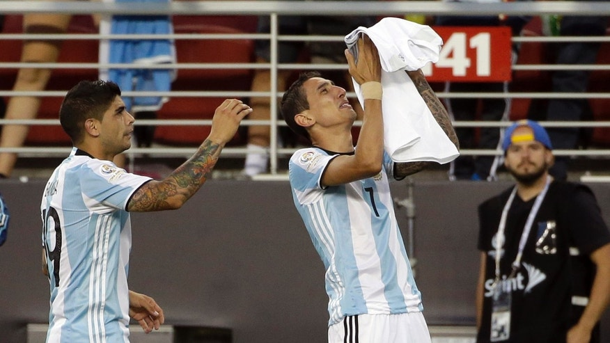 "Argentinaâs Angel Di Maria, right, holds a t-shirt that reads ""grandmother I will miss you a lot"" after he scored against Chile during a Copa America Centenario Group A soccer match at the Levi's Stadium in Santa Clara, Calif., Monday, June 6, 2016. At left is Argentinaâs Ever Banega. (AP Photo/ Marcio Jose Sanchez)"