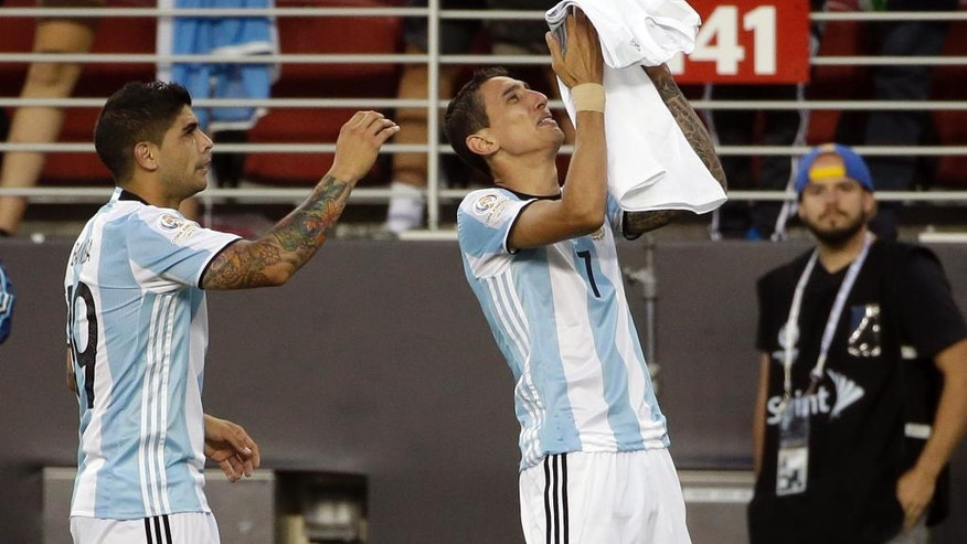 "Argentina's Angel Di Maria, right, holds a t-shirt that reads ""grandmother I will miss you a lot"" after he scored against Chile during a Copa America Centenario Group A soccer match at the Levi's Stadium in Santa Clara, Calif., Monday, June 6, 2016. At left is Argentina's Ever Banega. (AP Photo/ Marcio Jose Sanchez)"