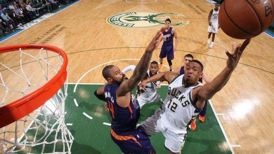 Jabari Parker of the Milwaukee Bucks shoots the ball Phoenix Suns.