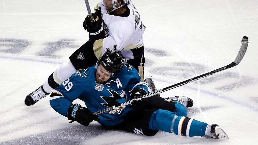 Pittsburgh Penguins' Matt Cullen, top, collides with San Jose Sharks' Logan Couture, bottom, during the first period of Game 4 of the NHL hockey Stanley Cup Finals on Monday, June 6, 2016, in San Jose, Calif. (AP Photo/Eric Risberg)