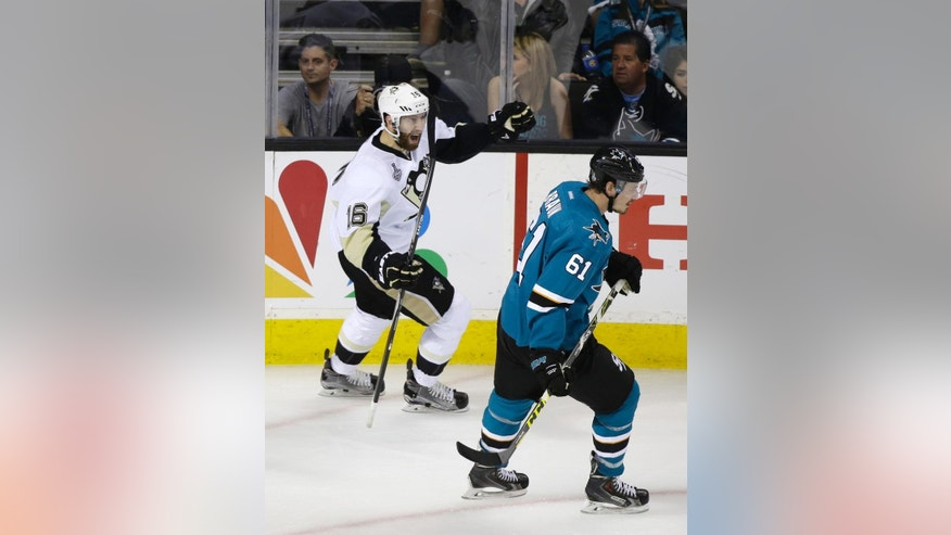 Pittsburgh Penguins right wing Eric Fehr, left, celebrates after scoring a goal as San Jose Sharks defenseman Justin Braun (61) looks on during the third period of Game 4 of the NHL hockey Stanley Cup Finals in San Jose, Calif., Monday, June 6, 2016. Pittsburgh won the game 3-1. (AP Photo/Eric Risberg)