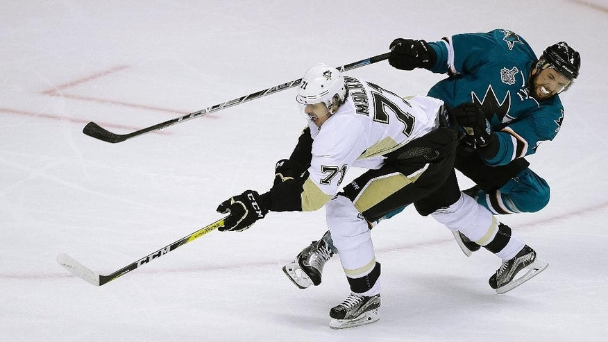 Pittsburgh Penguins' Evgeni Malkin, left, moves the puck past San Jose Sharks' Brenden Dillon during the second period of Game 4 of the NHL hockey Stanley Cup Finals, Monday, June 6, 2016, in San Jose, Calif. (AP Photo/Eric Risberg)