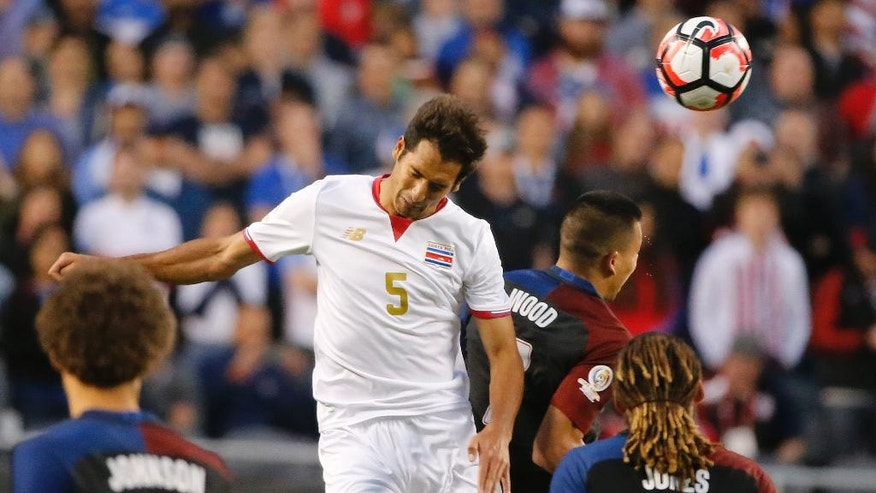 Costa Rica's Celso Borges (5) and United States' Bobby Wood (7) battle during a Copa America Centenario group A soccer match at Soldier Field in Chicago, Tuesday, June 7, 2016. (AP Photo/Charles Rex Arbogast)