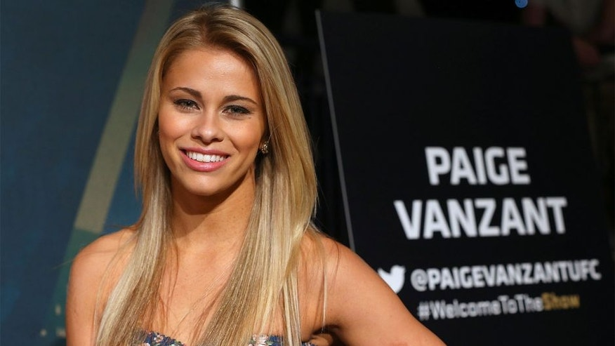 NEW YORK, NY - APRIL 16: Paige VanZant speaks to media and fans during the Ultimate Media Day at the Best Buy Theater on April 16, 2015 in New York, New York. (Photo by Ed Mulholland/Zuffa LLC/Zuffa LLC via Getty Images)