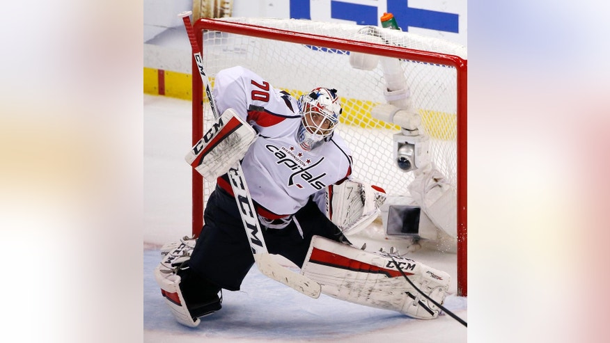 FILE - In this May 10, 2016 file photo, Washington Capitals goalie Braden Holtby blocks a shot during the third period of Game 6 in an NHL hockey Stanley Cup Eastern Conference semifinals against the Pittsburgh Penguins in Pittsburgh. Vezina Trophy finalist Holtby will represent the Washington Capitals in the annual Capital Pride Parade on Saturday, June 11, 2016, which the goaltender hopes is just the start of his involvement in the pro-gay-rights movement. (AP Photo/Gene J. Puskar, File)
