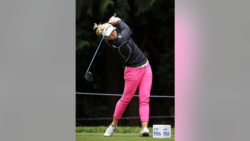 Brooke Henderson, of Canada, tees off in the first round of the Women's PGA Championship golf tournament at Sahalee Country Club Thursday, June 9, 2016, in Sammamish, Wash. (AP Photo/Elaine Thompson)