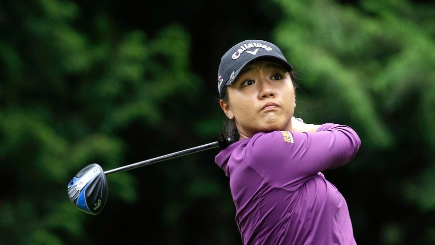 Lydia Ko, of New Zealand, tees off in the first round at the Women's PGA Championship golf tournament at Sahalee Country Club Thursday, June 9, 2016, in Sammamish, Wash. (AP Photo/Elaine Thompson)