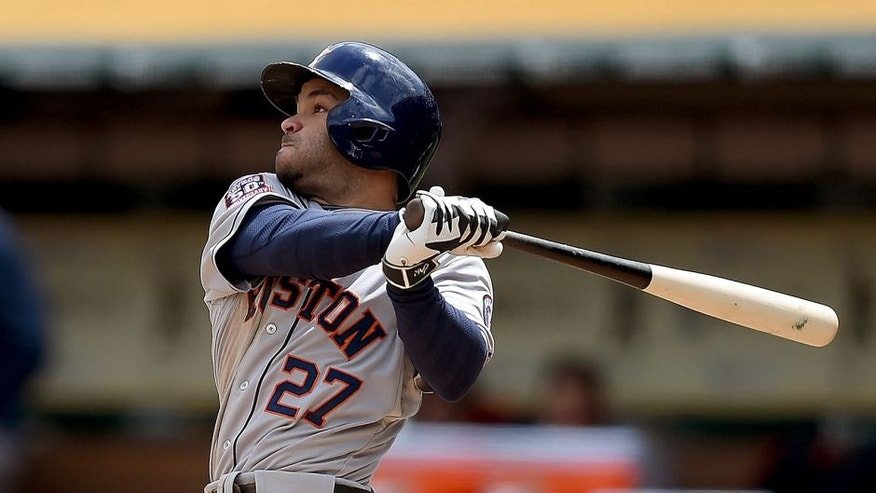 <p>OAKLAND, CA - APRIL 25: Jose Altuve #27 of the Houston Astros hits a three-run homer against the Oakland Athletics in the top of the second inning at O.co Coliseum on April 25, 2015 in Oakland, California. (Photo by Thearon W. Henderson/Getty Images)</p>