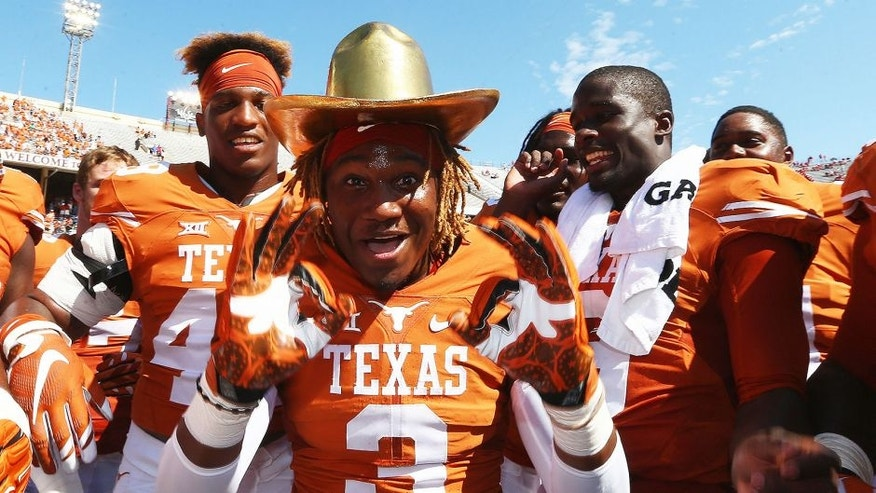 "<p>DALLAS, TX - OCTOBER 10: Armanti Foreman #3 of the Texas Longhorns celebrates with the Golden Hat trophy after a 24-17 win against the Oklahoma Sooners during the 2015 AT&T Red River Showdown at Cotton Bowl on October 10, 2015 in Dallas, Texas. (Photo by Ronald Martinez/Getty Images)</p> <div><span style=""color: rgb(26, 26, 26); font-family: 'Helvetica Neue', Helvetica, Arial, sans-serif; line-height: 18px; background-color: rgb(255, 255, 255);""> </span></div>"