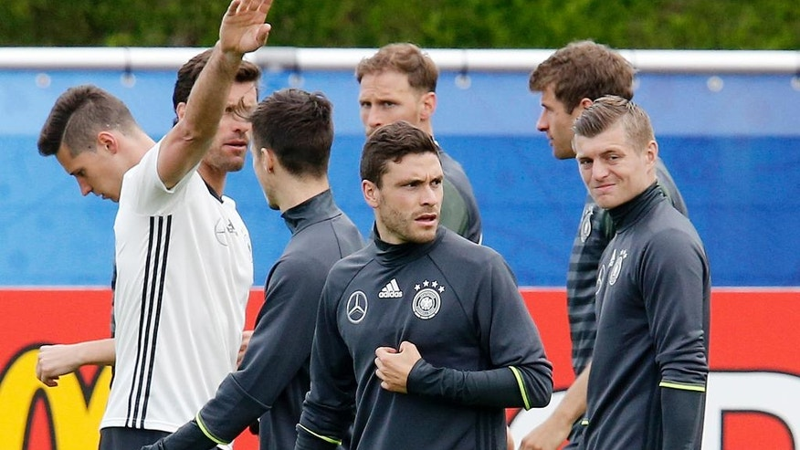 Jonas Hector, center, attends a training session of the German national soccer team in the Camille Fournier stadium at their base camp in Evian, France, Thursday, June 9, 2016. Germany will face the Ukraine in a Euro 2016 Group C soccer match in Lille on Sunday, June, 12, 2016. (AP Photo/Michael Probst)