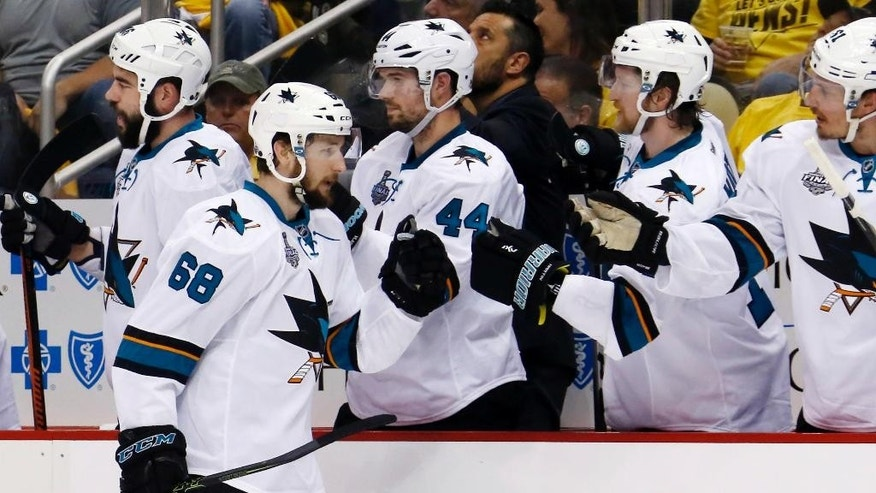 San Jose Sharks' Melker Karlsson (68) celebrates his goal against the Pittsburgh Penguins with teammates on the bench during the first period in Game 5 of the NHL hockey Stanley Cup Finals on Thursday, June 9, 2016, in Pittsburgh. (AP Photo/Keith Srakocic)