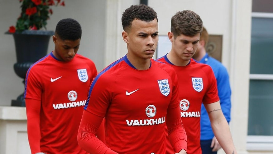 England's Dele Alli , centre, leaves the team hotel in Chantilly, France, Thursday, June 9, 2016. England will face Russia in a Euro 2016 Group B soccer match in Marseille on Saturday, June 11. (AP Photo/Kirsty Wigglesworth)