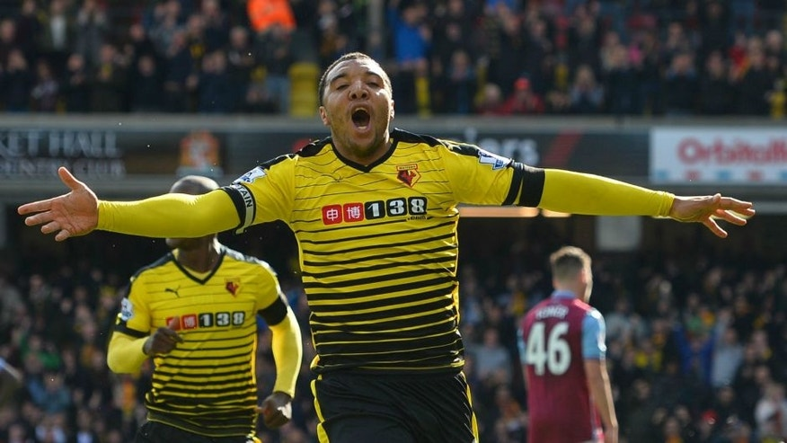 Watford's English striker Troy Deeney celebrates after scoring his second goal during the English Premier League football match between Watford and Aston Villa at Vicarage Road Stadium in Watford, north of London on April 30, 2016. / AFP / GLYN KIRK / RESTRICTED TO EDITORIAL USE. No use with unauthorized audio, video, data, fixture lists, club/league logos or 'live' services. Online in-match use limited to 75 images, no video emulation. No use in betting, games or single club/league/player publications. / (Photo credit should read GLYN KIRK/AFP/Getty Images)
