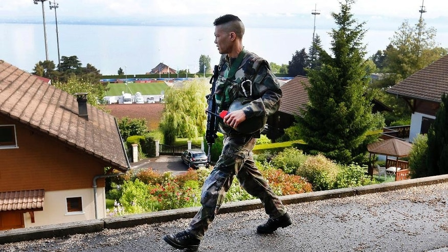 A French army soldier patrols high above the Lake Geneva and the Camille Fournier stadium where the German national soccer team trains in Evian, France, Thursday, June 9, 2016. Germany will face the Ukraine in a Euro 2016 Group C soccer match in Lille on Sunday, June, 12, 2016. (AP Photo/Michael Probst)
