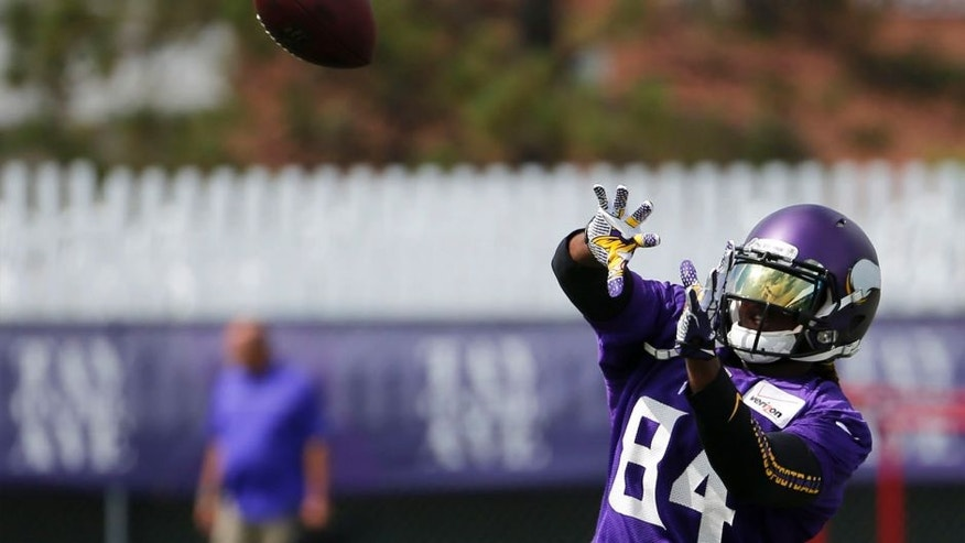 Monday, July 27: Minnesota Vikings wide receiver Cordarrelle Patterson keeps his eye on the ball during practice at training camp on the campus of Minnesota State University in Mankato, Minn.