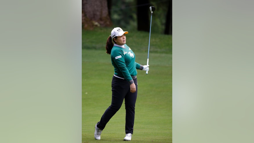 Inbee Park, of South Korea, watches her shot on the fourth hole fairway in the second round at the Women's PGA Championship golf tournament at Sahalee Country Club Friday, June 10, 2016, in Sammamish, Wash. (AP Photo/Elaine Thompson)