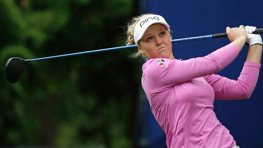 Brooke Henderson, of Canada, tees off on the seventh hole in the second round at the Women's PGA Championship golf tournament at Sahalee Country Club Friday, June 10, 2016, in Sammamish, Wash. (AP Photo/Elaine Thompson)